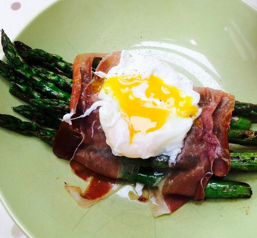 Asparagus and parma parcels with poached egg and parmesan