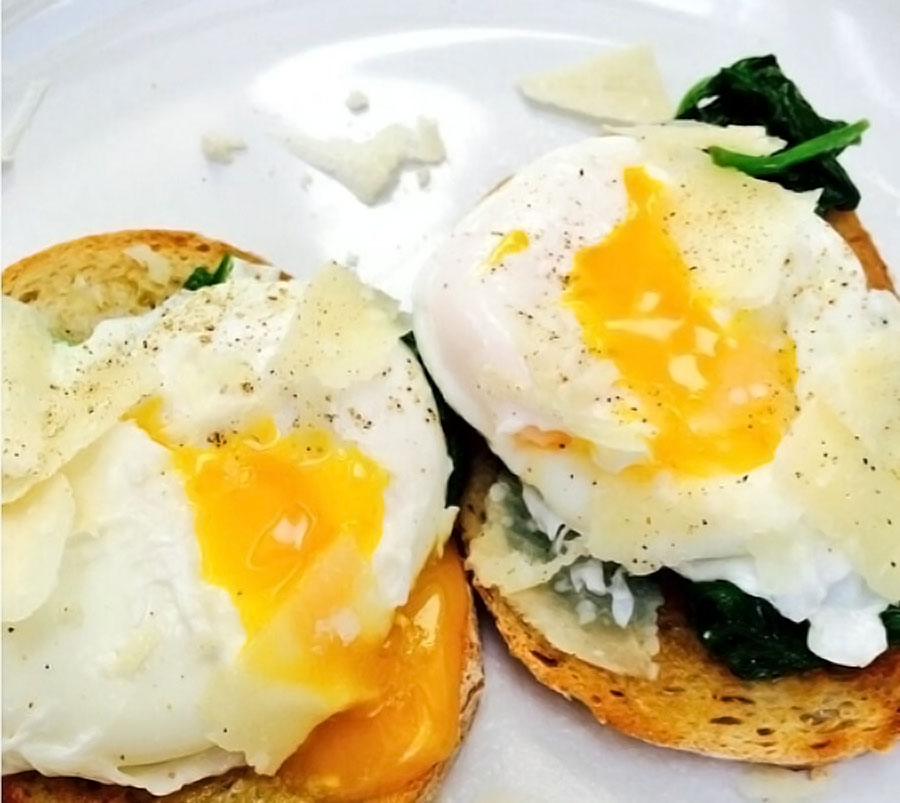 Poached eggs, spinach and parmesan on sourdough