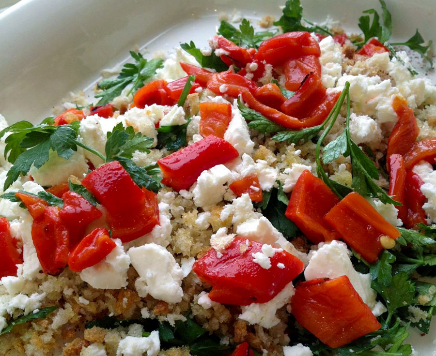Baked fish with feta, roasted peppers and breadcrumbs