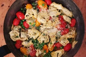One-pan Parmesan, pea and tomato tortellini